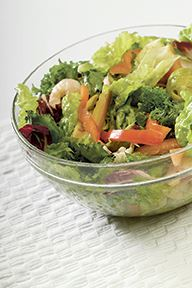 Bowl of salad with shrimp and vegetables