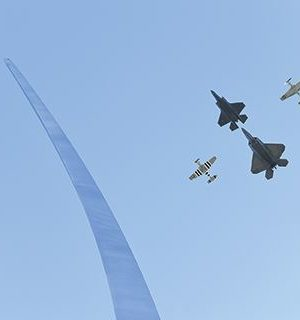 A four-ships formation performs a flyover during the Air Force Memorial's 10th anniversary ceremony in Arlington